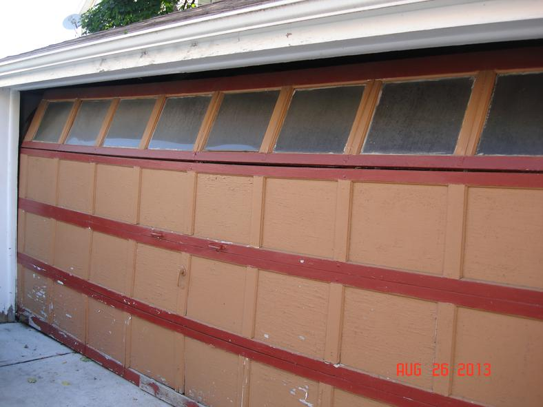 Old wood garage door with broken top section