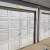 Here is a Picture BEFORE EazyLift Garage Door Company Began The Work,  Our Professional Garage Door Installation Team Installed Two New Vinyl 8700 Garage Doors, We also Installed Two Garage Door Openers and Finished Our Garage Door Installation With Some Aluminum Capping.