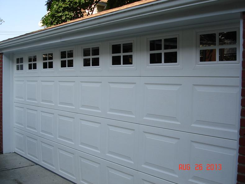 Installed a brand new vinyl garage door with window inserts and aluminum capping